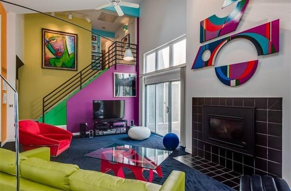 I knew he loved contemporary homes and black and white. He also collects art. Together, we brought his taste and style into the design with bold colors, modern art and furniture.